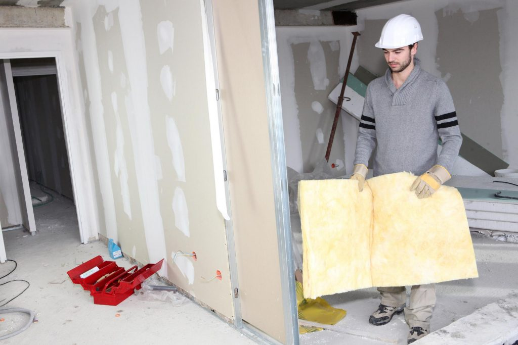 young male worker holding a insulation foam