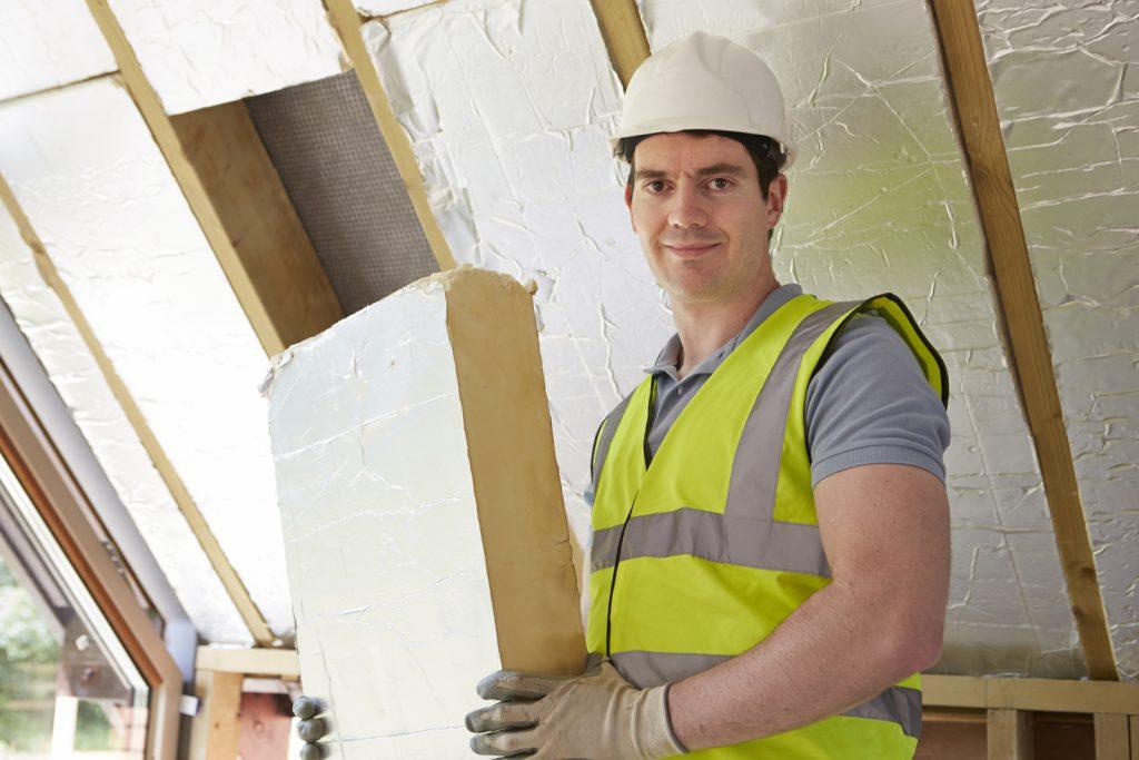 male worker holding an insulation foam
