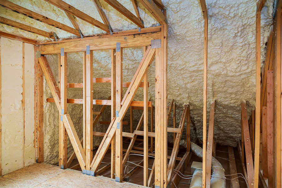 thermal and hydro insulation with spray foam at house construction site